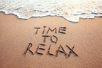 Time to Relax written in the sand